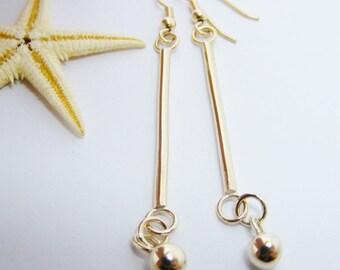Long bar gold earrings, with solid gold ball drops. Handmade long gold earrings