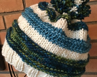 Soft soft soft  100% merino wool striped warm winter hat.  Some pop of color with the happy pompom on top.
