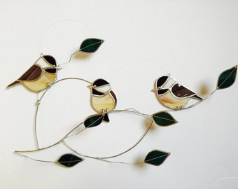 Chickadee trio group stained glass suncatcher , birds on a 3 dimentional wire branch adorned with green glass leaves.