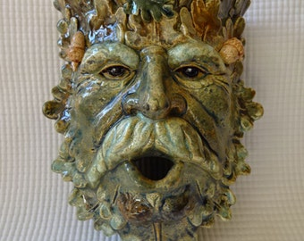 Ceramic Green Man wall sconce in mottled colors with acrons and leaves in crown