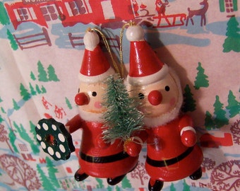 two painted wooden santa claus