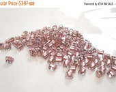 50% Off Seed bead, Toho Beads®, glass, clear color-lined pink, 5x5x5mm triangle with triangle hole. approx 130 beads GB 703