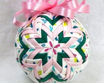 Quilted Ornament in Pastels and Dark Green colors.