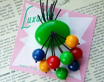 Telephone cord purse inspired brooch! Handmade 1940s green bakelite fakelite style novelty cherry brooch by Luxulite