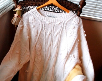 classy vintage 90s white cotton  hand ,  cable knit, fisherman, slouchy sweater with a bobbly.  Made by Peter Valentine. SizeL.