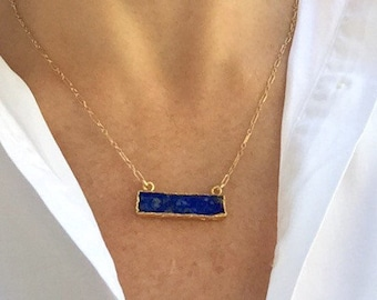 Gold framed lapis rectangle pendant on gold chain necklace