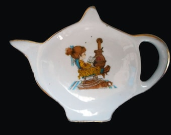 Vintage Teabag Holder 1970s Cute Girl Reading A Book by Pot Bellied Stove China Bag Dish Spoon Rest Tiny Decorative Teapot Shape Enesco