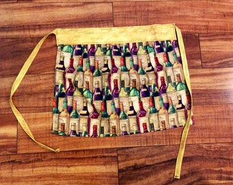 BOTTLE BABE wine themed half apron with greens, purples, burgundy, and golds