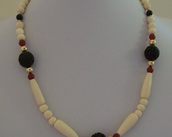 Carved Black Wooden Beads, Gold Beads, with Bone and Carnelian Gemstone Necklace by Carol Wilson of Je t'adorn