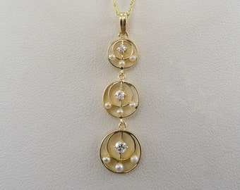 A Turn of the Century Art Nouveau-Edwardian Lavalier, 14k Yellow Gold with Diamonds and Seed Pearls (A1850)