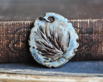 Nature Ceramic Pendant in Lake Superior Blue, handcarved and impressed with a real Wisconsin Evergreen, great with jeans!