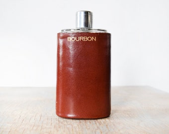 bourbon flask, vintage glass flask with leather case