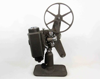 "Vintage Revere Eight ""85"" 8mm Film Projector with Case and Instructions. Circa 1940's."