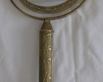 Mid Century Hollywood Regency Brass Swiveling Make Up Mirror with Great Fleur de Lis Design