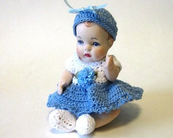 "porcelain doll 5"" handcrafted with a blue crocheted dress"