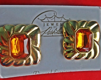 """Vintage Park Lane signed gold tone 1.5"""" clip earrings with gold rhinestone centers in unworn condition on Park Lane card"""