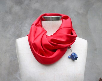 Red silk weighted scarf with large blue howlite skull charm