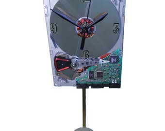 Early 1980s Hard Drive Pendulum Clock. Pendulum is a Laptop Disk Platter. Historical Gadget.