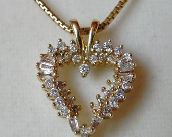 14 kt Gold Heart and Diamond Pendant. 38 Stones, 9 Tapered Baguettes and 29 Round Cuts. Keepsake Diamonds.