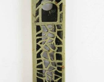 A vintage metal mezuzah made in Israel.