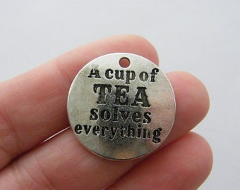 BULK 10 A cup of tea solves everything charms antique silver tone M798