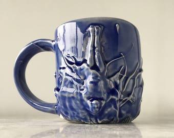 Goddess mug ceramic art cup bas relief figure sculpture porcelain pottery skinny dip vessel slip trailing texture, blue glaze swimmer