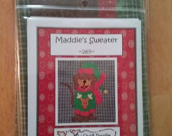 Maddie's Sweater, a labrador dog  applique Tea Towel Kit  pattern with a navy blue tea towel