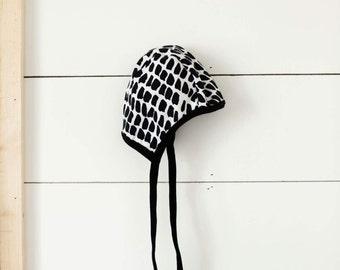 Black and white dot print pilot hat, baby hearing aid hat, baby cap, hat with ties, toddler cap, baby boy hat, baby girl hat, emmifaye hat