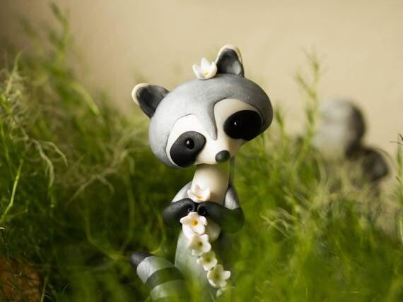Raccoon Making a Daisy Chain - Raccoon Sculpture by Bonjour Poupette