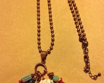 Eclectic elephant boho copper necklace with blue green tassel