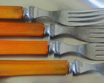 Four butterscotch bakelite handle Chrome Plate forks 30s 40s 50s