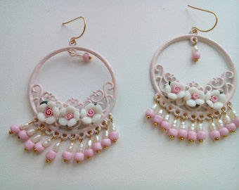Pink filigree earrings with flowers