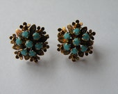 Snowflake Flower earrings. Faux turquoise, gold tone metal.  English lock.