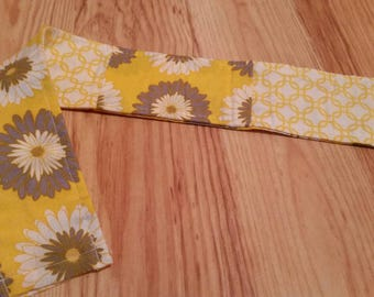 Yellow and white reversable camera strap slipcover