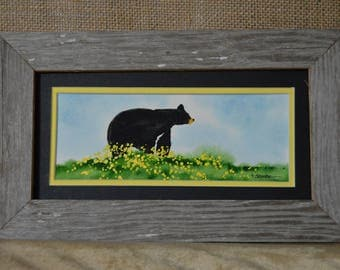 Rustic Framed Black Bear in yellow flowers on a Fall day