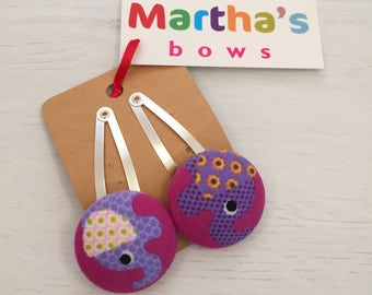Purple elephant fabric covered button snap clip pair