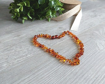 Natural amber teething necklace from cognac coloured amber rounded beads