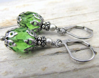 Peridot green earrings minimalist tiny glass drop antique style dark silver end caps stainless steel lever back ear wires closed earrings