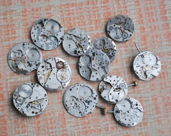 0.8 inch Set of 12 vintage wrist watch movements.