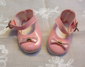 Vintage pair faux leather doll shoes in pink