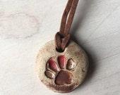 Handmade stoneware pendent paw print