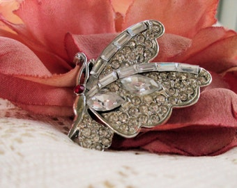 Rhinestone vintage Butterfly brooch side view with all clear glass stones and red eye gorgeous