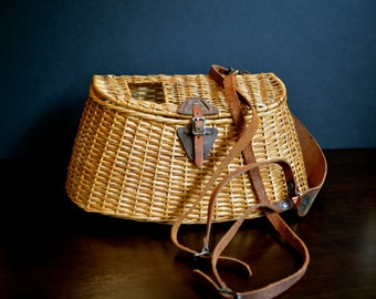 vintage wicker fishing basket with leather strap