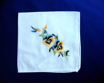 Sweet hand embroidered hankie hanky handkerchief flowers pansies in yellow and blue with black accents and green leaves