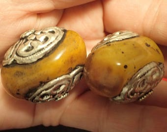 Two Large Vintage Amber Beads in Tibetan Silver