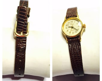 Vintage Timex Wrist Watch, gold Tone, brown leather band, Clearance Sale, Item No. B200