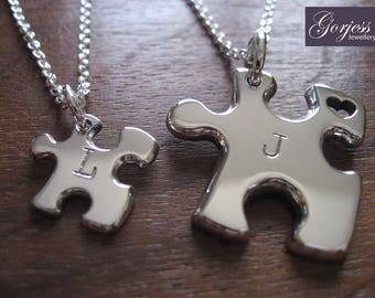 Two Silver Handmade Puzzle Pendants, One big and one small!