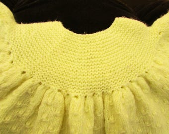 Hand knitted yellow baby girl dress
