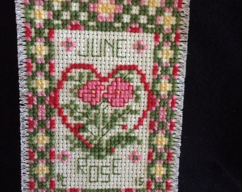 June Rose Ornament / the cross stitch looks hand done