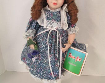 Vintage porcelain ringlet brown hair blue eyed 15 inch doll purple flowered  dress  Flower Girl Exclusive used